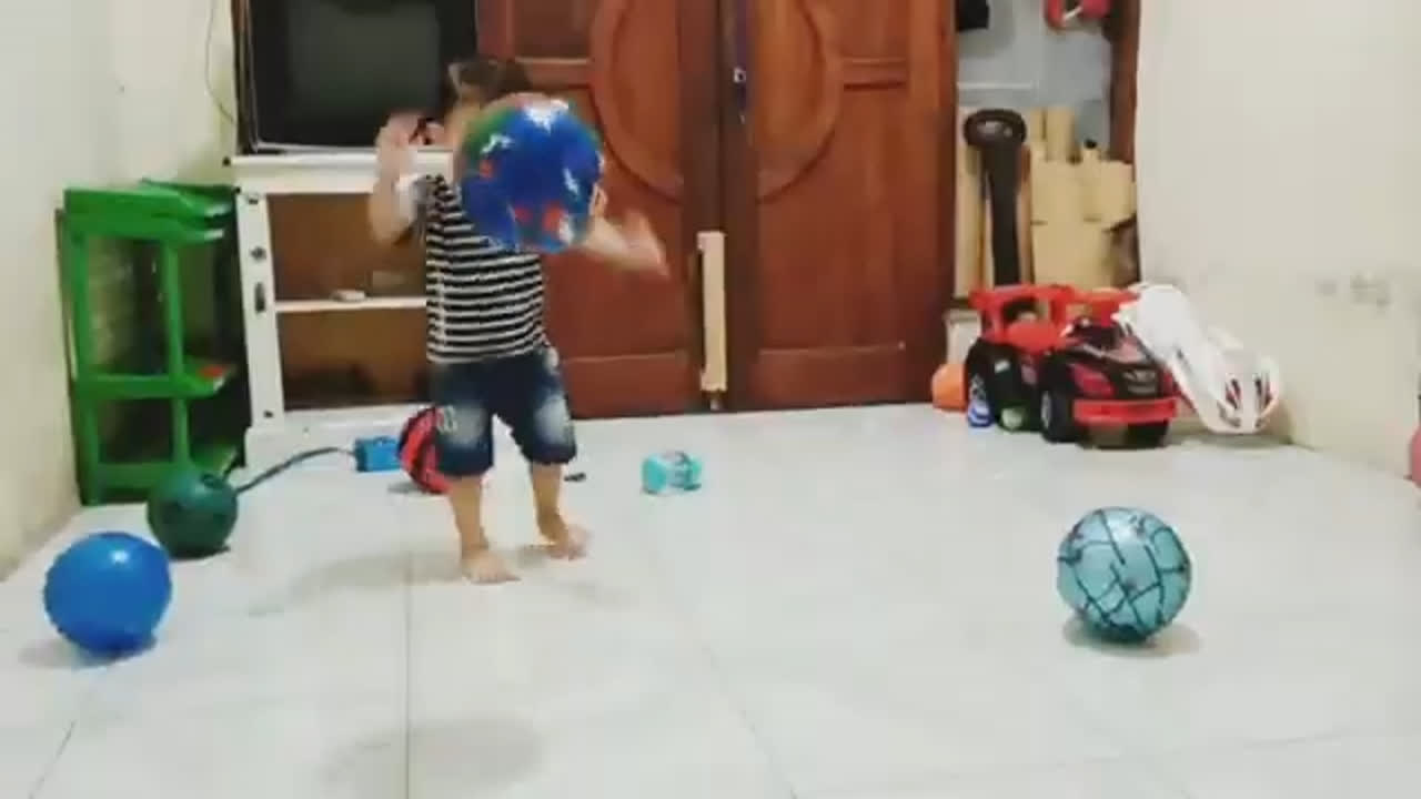 Baby kids playing the soccer football